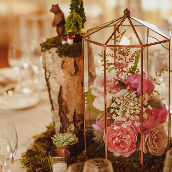Handmade table centrepieces were adorned with stunning florals for their wedding breakfast at Gaynes Park