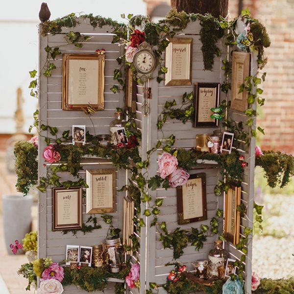 The couple created a stunning woodland themed table plan for their wedding breakfast at Gaynes Park