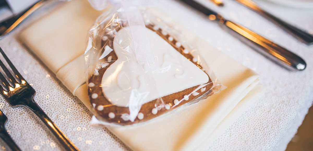 For their summer wedding at Gaynes Park the couple gave heart-shaped biscuits as wedding favours