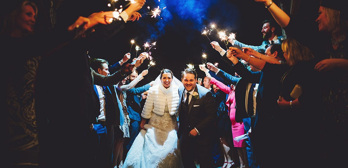A bride and groom have a sparkler send off at the end of their winter wedding at Gaynes Park