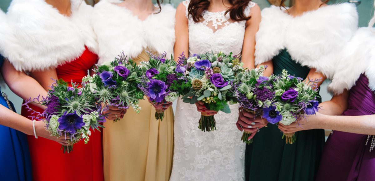 Bridesmaids wear jewel coloured dresses for a winter wedding at Gaynes Park in Essex