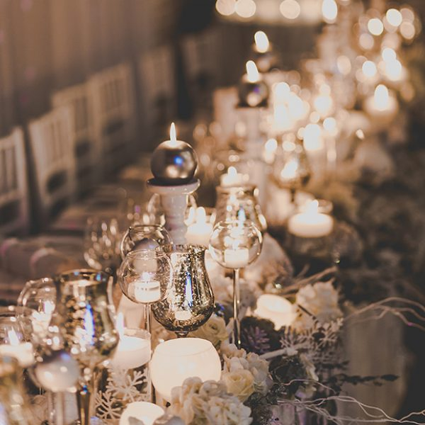 Candles create a cosy atmosphere for a winter wonderland inspired wedding at Gaynes Park