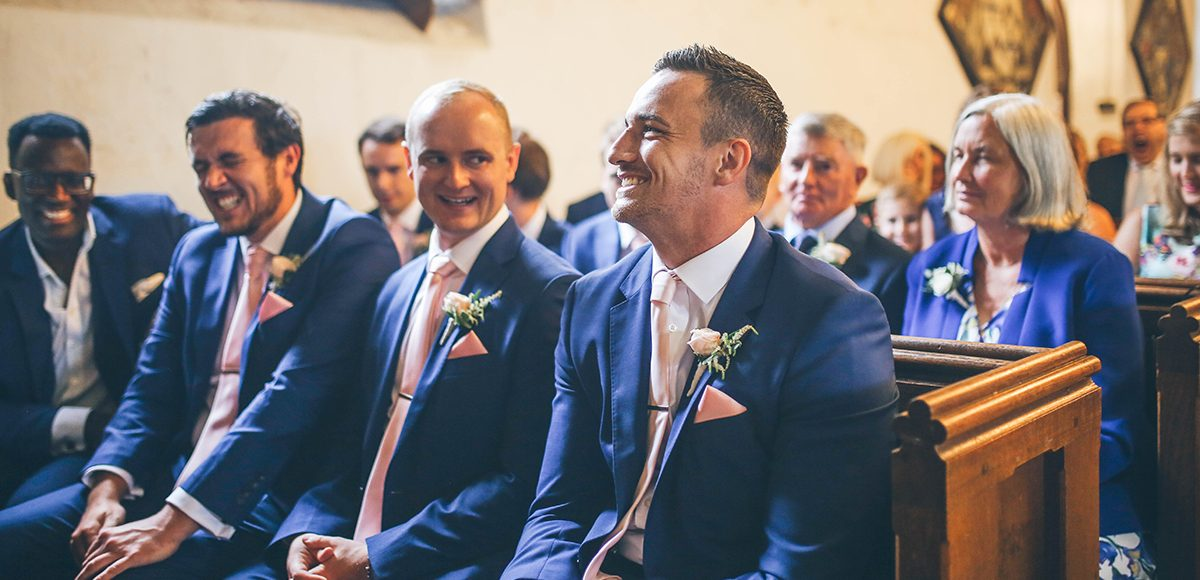 The groom and his groomsmen wear royal blue suits for this summer wedding at Gaynes Park