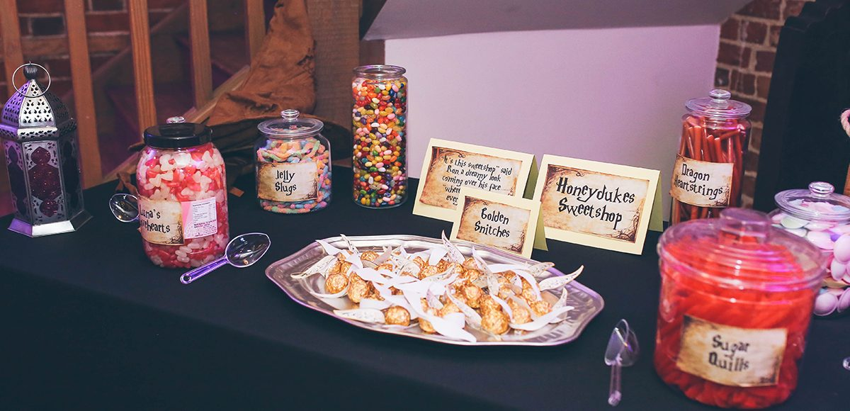 The couple created a fantastic Harry Potter inspired sweet table for their summer wedding at Gaynes Park