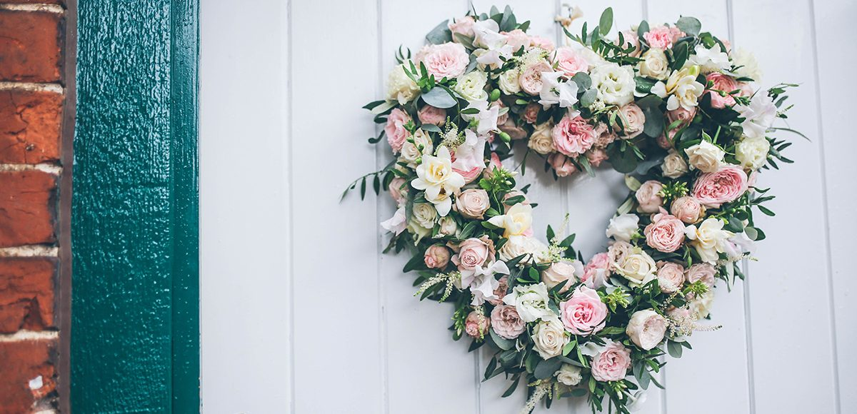 At Gaynes Park a heart-shaped floral wreath decorated the door of the Apple Loft Cottage