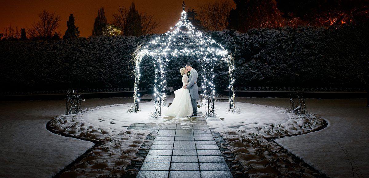 Newlyweds make the most of the stunning snow during their winter wedding evening at Gaynes Park