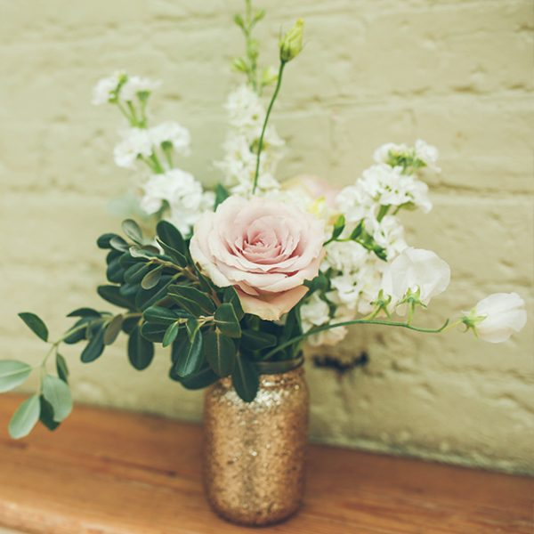 Gold jars of wedding flowers decorated Gaynes Park for this beautiful summer wedding