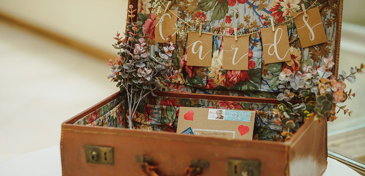 Old suitcases are perfect for a rustic wedding at Gaynes Park