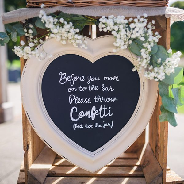 A couple provided instructions for guests at Gaynes Park with a rustic wedding sign