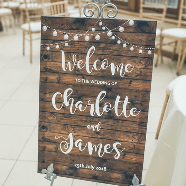 A welcome sign greeted guests to this summer wedding at Gaynes Park in Essex