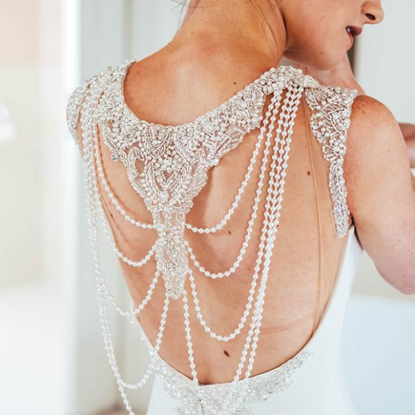 The bride wore a beautiful white gown with a stunning beaded back for her wedding at Gaynes Park