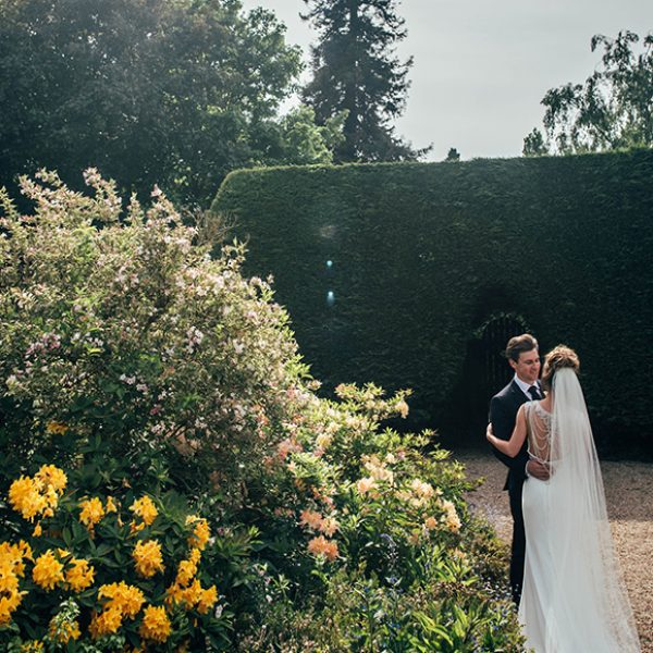 The bride and groom share a moment on the Long Walk at Gaynes Park during their wedding day