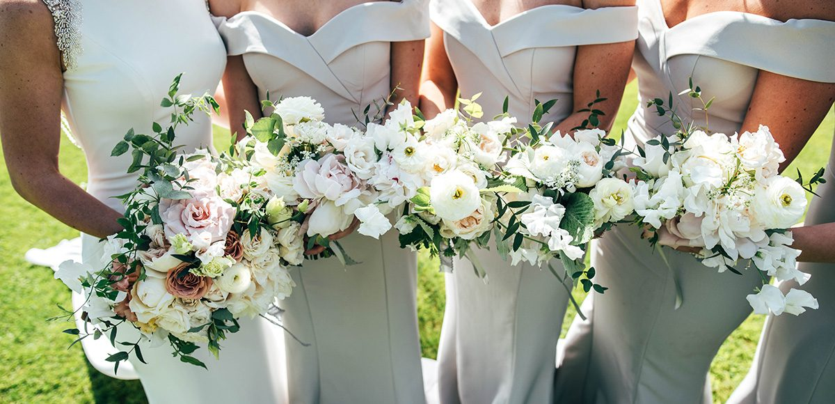 Bridesmaids wore grey bardot style bridesmaids dresses for this classic wedding at Gaynes Park
