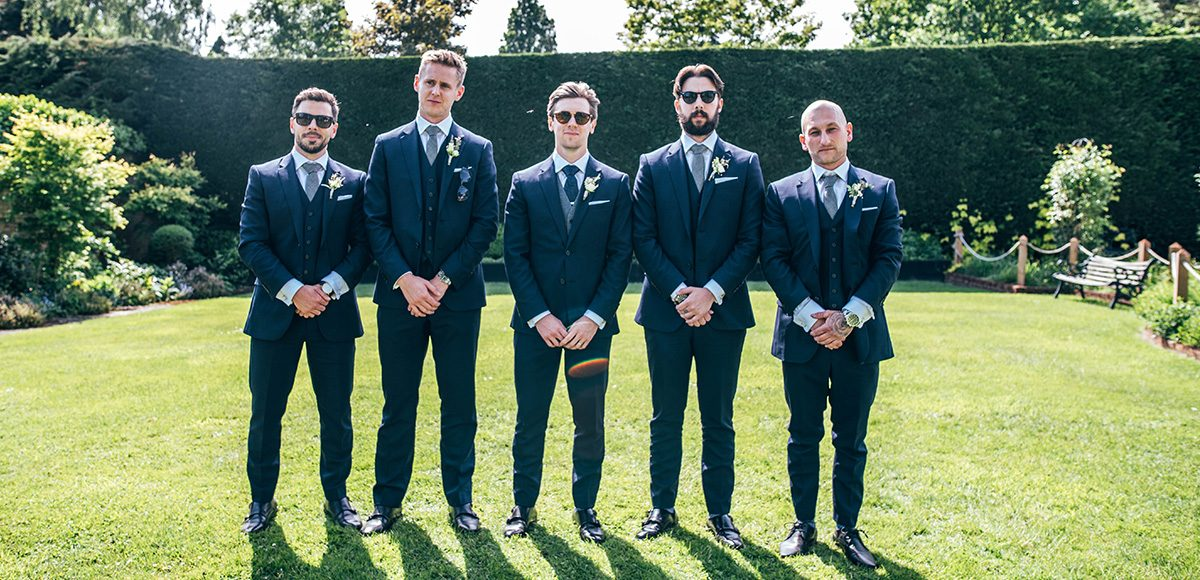 The groom and his groomsmen wore navy suits for this summer wedding at Gaynes Park