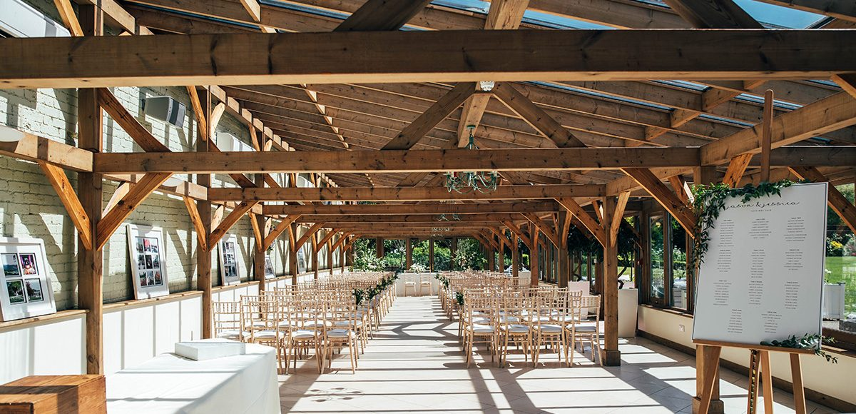 The Orangery at Gaynes Park is set up for a beautiful summer wedding ceremony