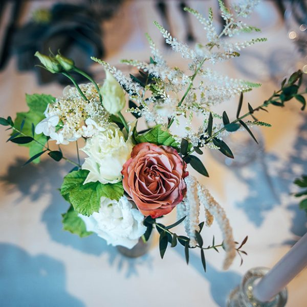 The couple chose pink and white wedding flowers for their wedding day at Gaynes Park in Essex