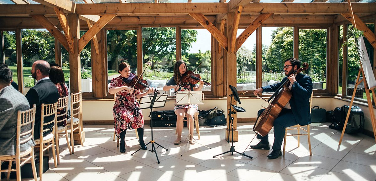 A string trio played during the wedding ceremony in the Orangery at Gaynes Park