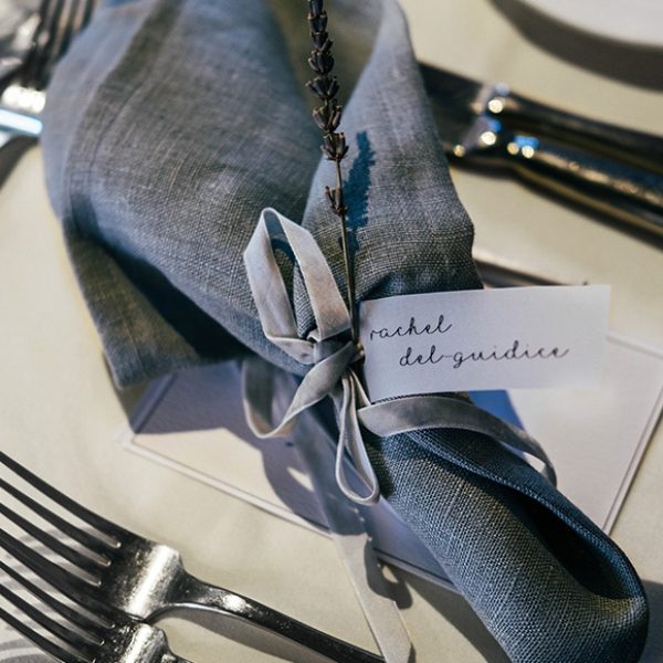 Grey napkins were placed at each table setting for this classic wedding breakfast at Gaynes Park