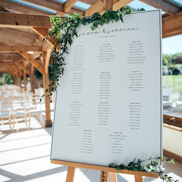 A simple table plan was adorned in green foliage for this summer wedding at Gaynes Park