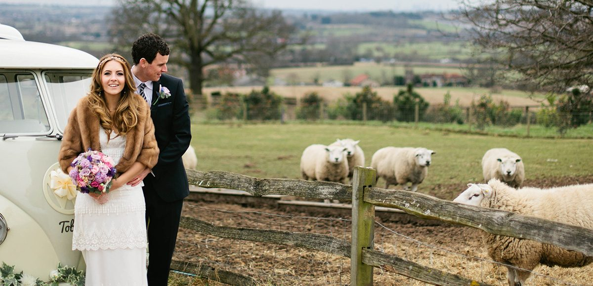 A bride and groom enjoy the glorious countryside that surround Gaynes Park wedding venue in Essex