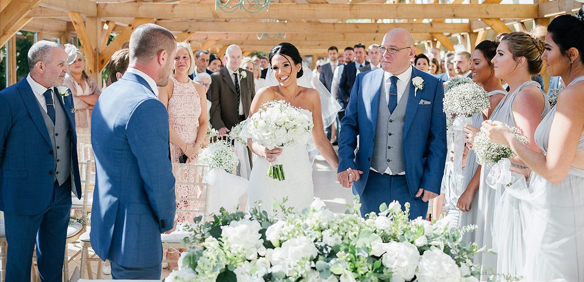 The bride and groom enjoy their wedding ceremony in the Orangery at Gaynes Park wedding venue in Essex