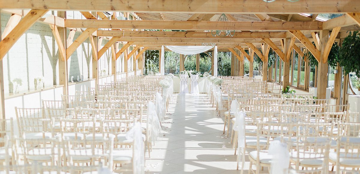 The Orangery at Gaynes Park in Essex is a beautiful space for a light and bright wedding ceremony