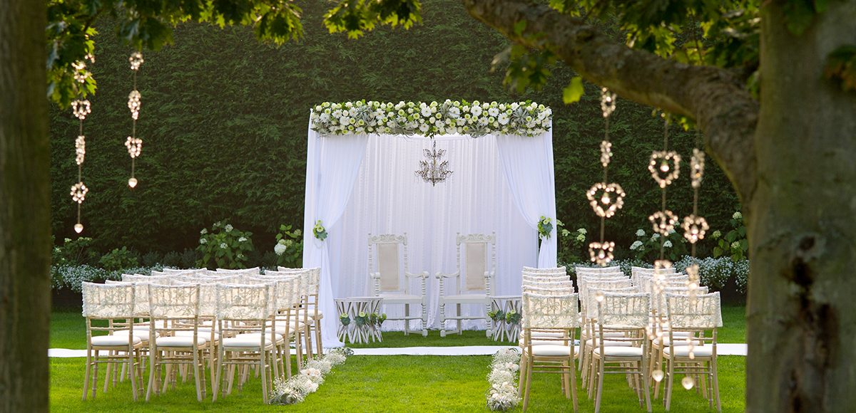 The gardens at Gaynes Park in Essex are set up for a beautiful outdoor wedding ceremony