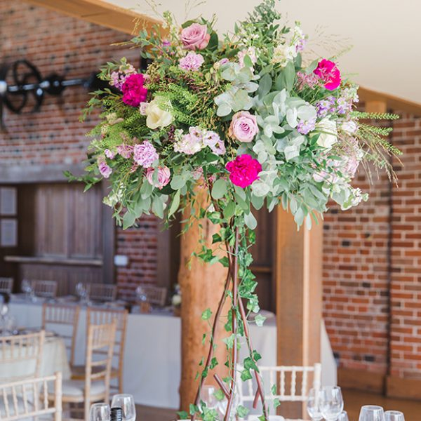 High floral stands created beautiful table centrepieces for a wedding breakfast in the Mill Barn at Gaynes Park