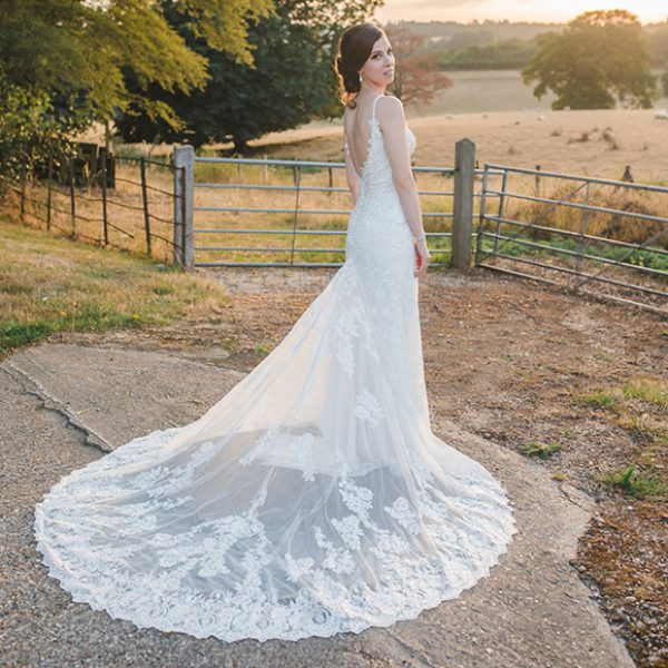 The bride wore a lace bridal gown for her summer wedding day at Gaynes Park in Essex