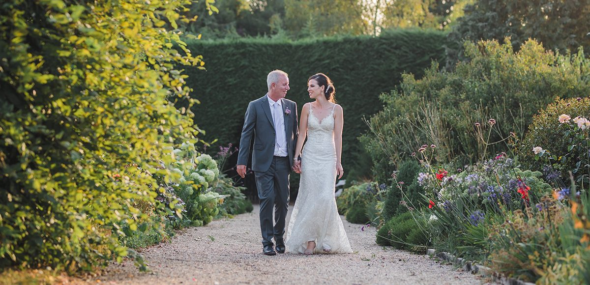 Newlyweds make the most of the beautiful Long Walk at Gaynes Park in Essex
