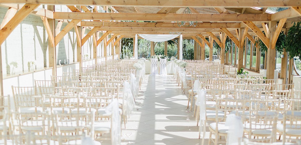 The Orangery at Gaynes Park wedding venue in Essex is set up for a beautiful wedding ceremony