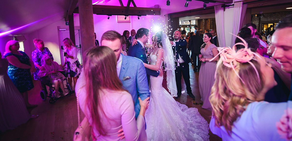 Wedding guests enjoy an evening reception at Gaynes Park wedding venue in Essex