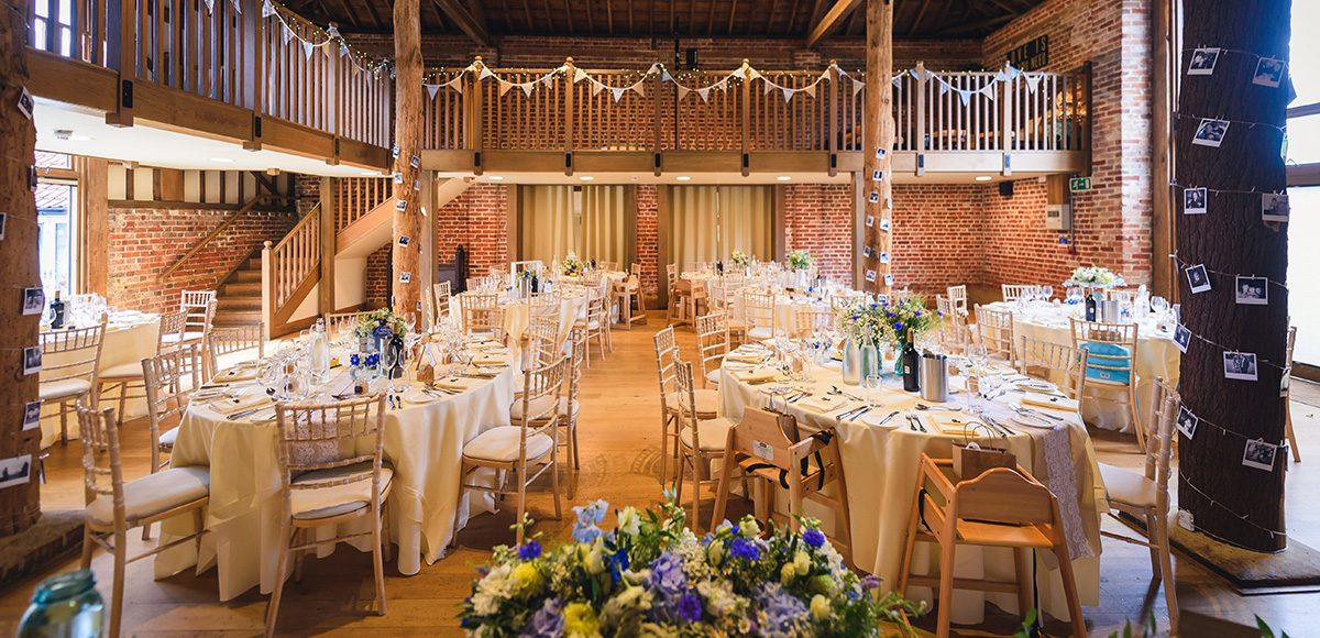 The Mill Barn at Gaynes Park in Essex is set up for a rustic wedding reception