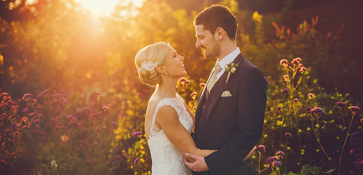 The newlyweds make the most of the beautiful gardens at Gaynes Park in Essex during the golden hour