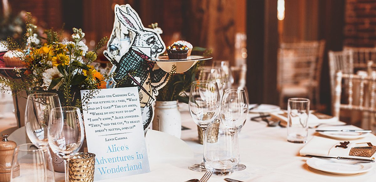 One table was inspired by Alice in Wonderland for this vintage wedding at Gaynes Park