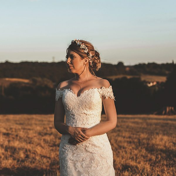 The bride wore a flower crown for her vintage inspired wedding day at Gaynes Park