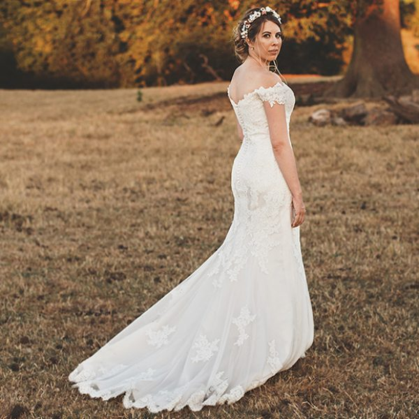 The bride wore a fishtail off the shoulder wedding gown for her wedding at Gaynes Park in Essex