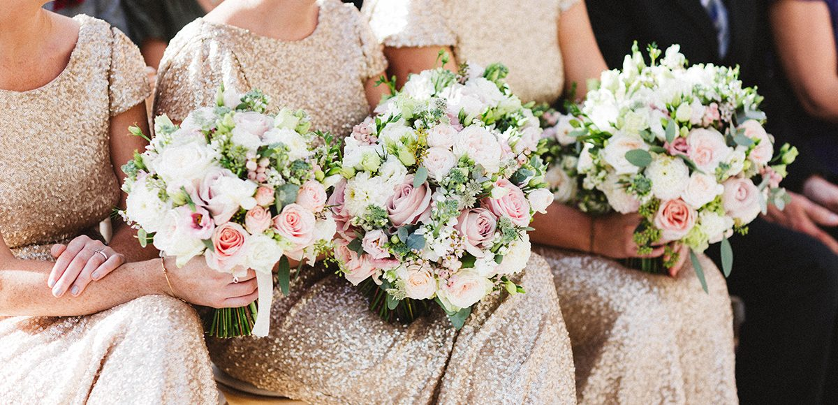 Bridesmaid bouquets are made up of pink roses for a beautiful spring wedding at Gaynes Park