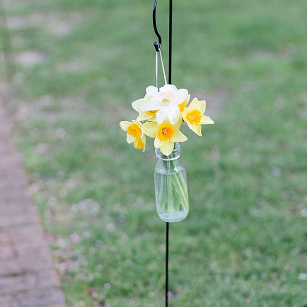 Daffodils sit in jars for a beautiful spring wedding at Gaynes Park in Essex