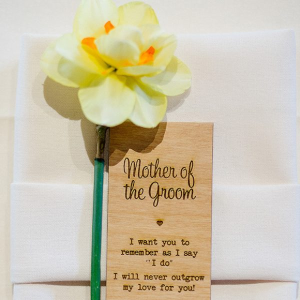 Daffodils create an additional element to a spring wedding favour at Gaynes Park