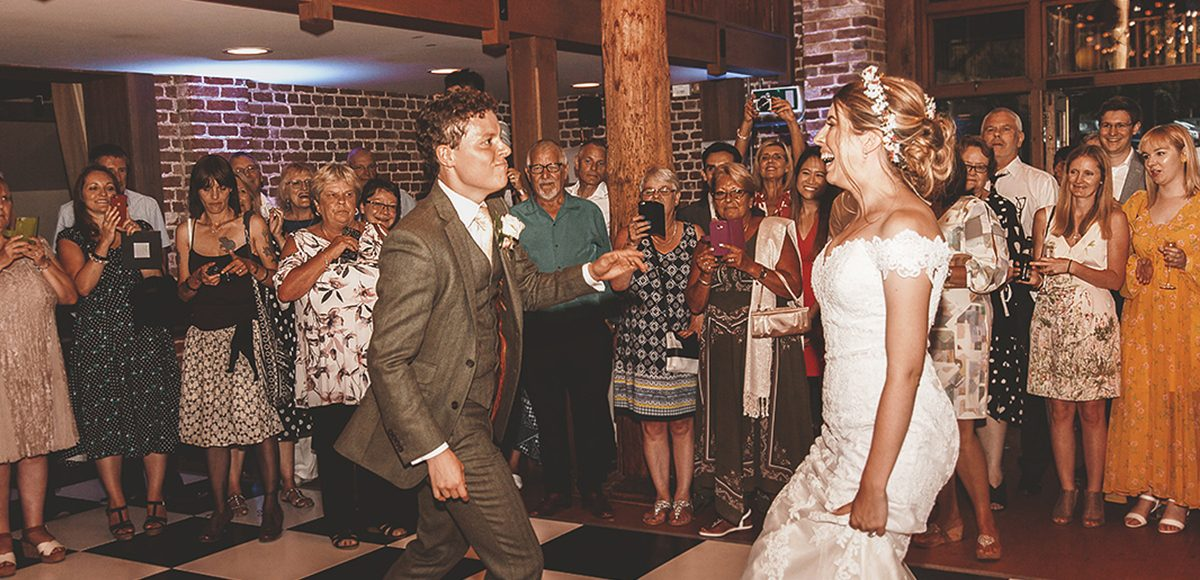 The newlyweds perform their first dance in front of guests at Gaynes Park