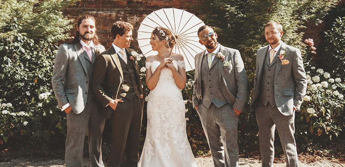The groom and groomsmen wore tweed suits for this vintage summer wedding at Gaynes Park