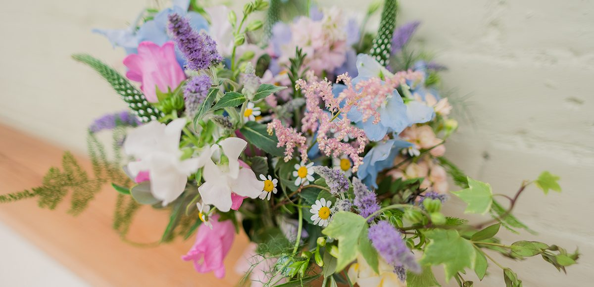 Sweet peas and wild florals create a beautiful spring wedding bouquet for a bride at Gaynes Park