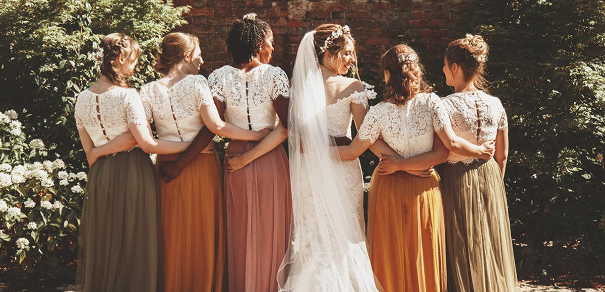 The bridesmaids wore vintage inspired tulle skirts with matching lace tops for this summer wedding at Gaynes Park