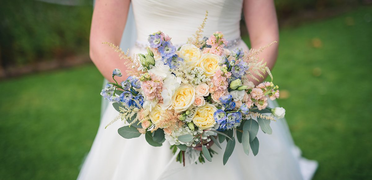 A wedding bouquet made up of lemon peonies is perfect for a spring wedding at Gaynes Park