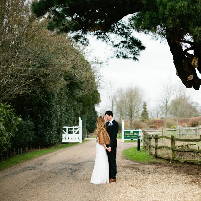 Bride and groom enjoy the countryside views from Gaynes Park's grounds