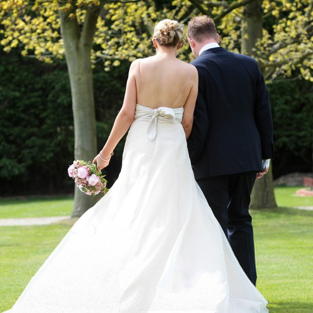 Bride and groom enjoying the gardens of Gaynes Park wedding venue in Essex