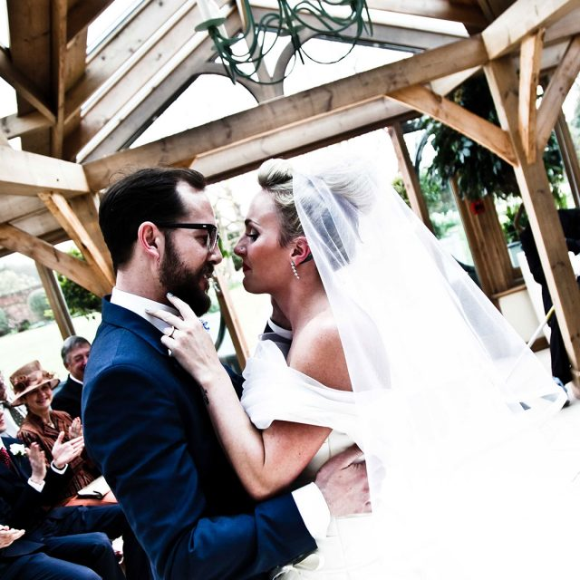 Bride and groom during their Gaynes Park ceremony in the Orangery – Essex wedding venues
