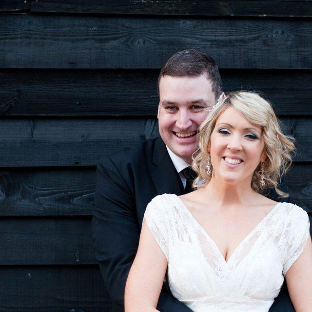 Bride and groom outside Gaynes Park posing for photos – wedding barns Essex