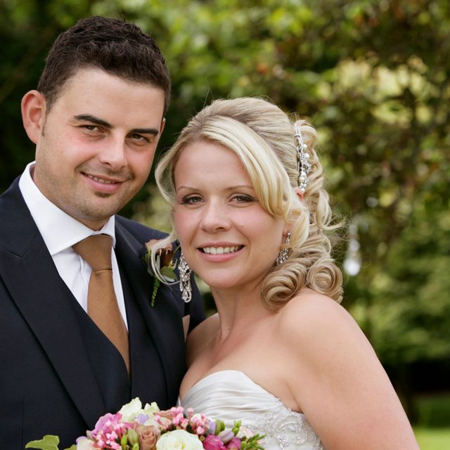 Summer bride and groom in the gardens